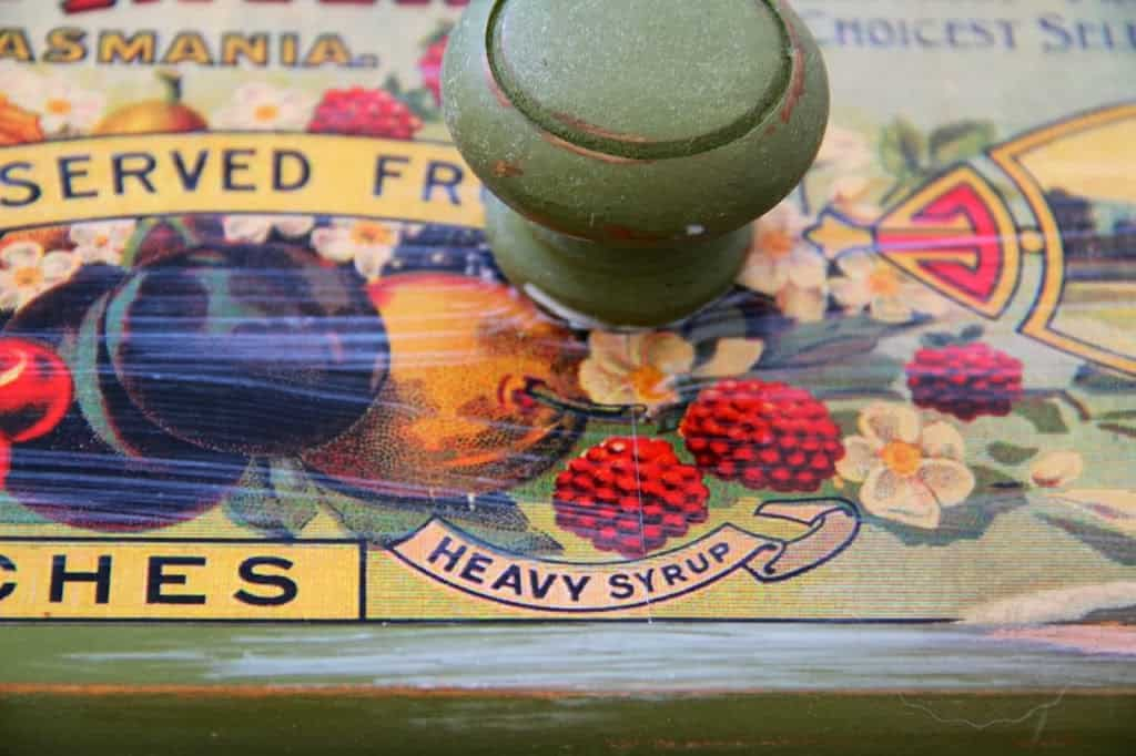 Mod podge over antique can label on drawer