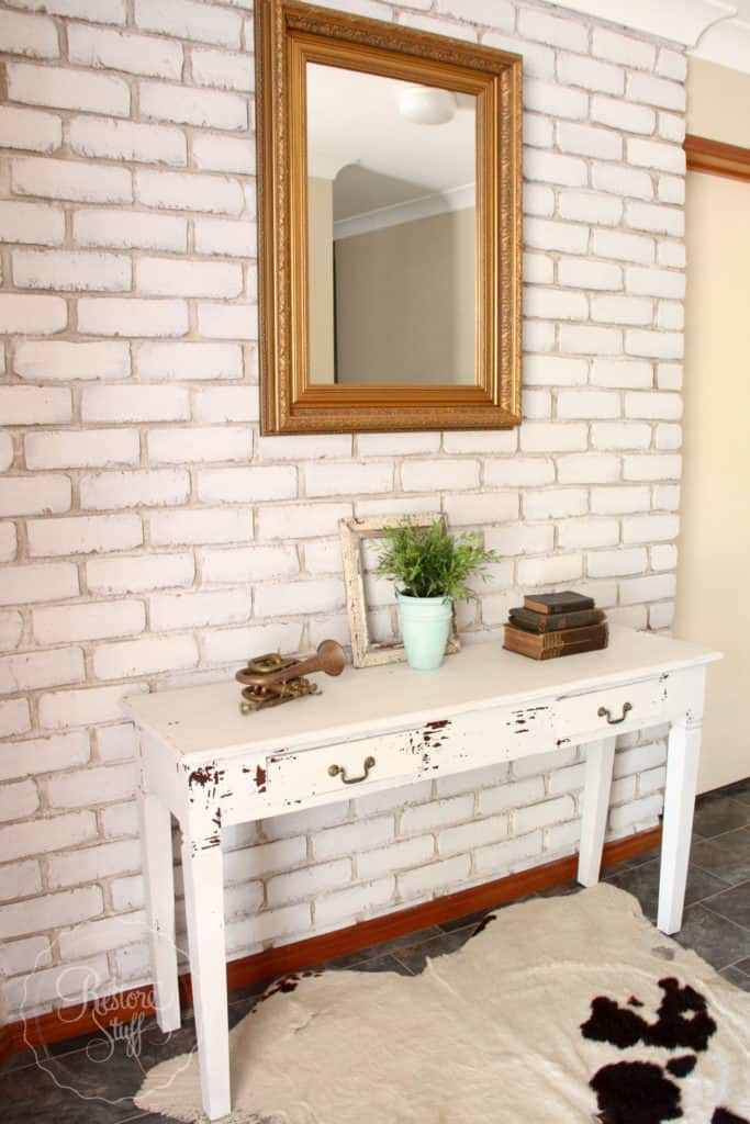 Brick wall painted with milk paint