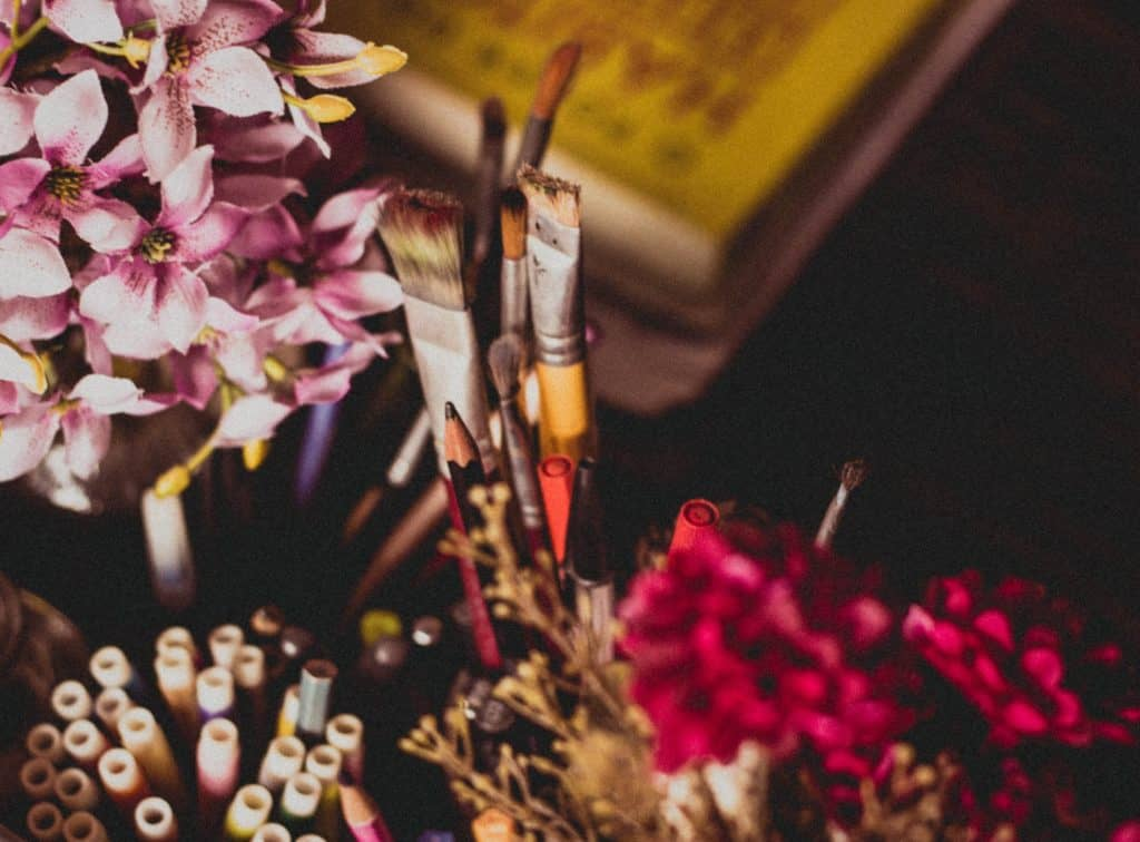paint brushes Photo by Ella Jardim on Unsplash