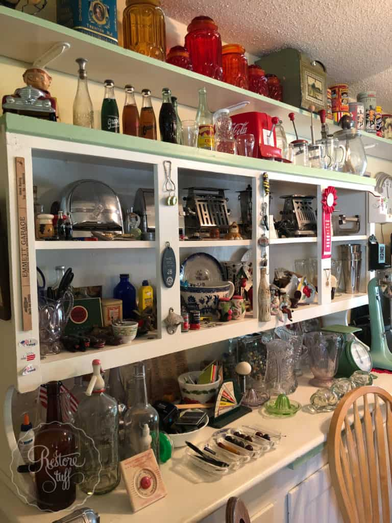 antiques & collectables kitchen cabinet filled