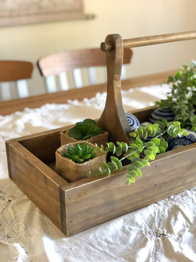 table caddy with greenery