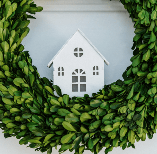 light up house in boxwood wreath
