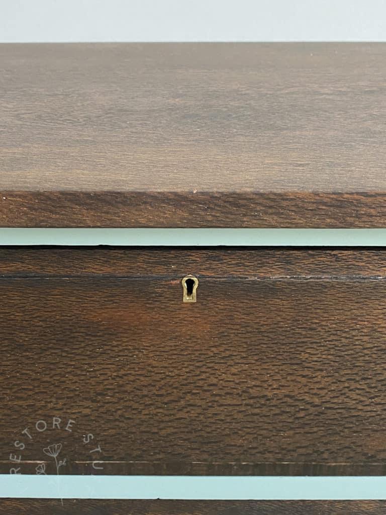 close up silky oak dresser drawer key hole