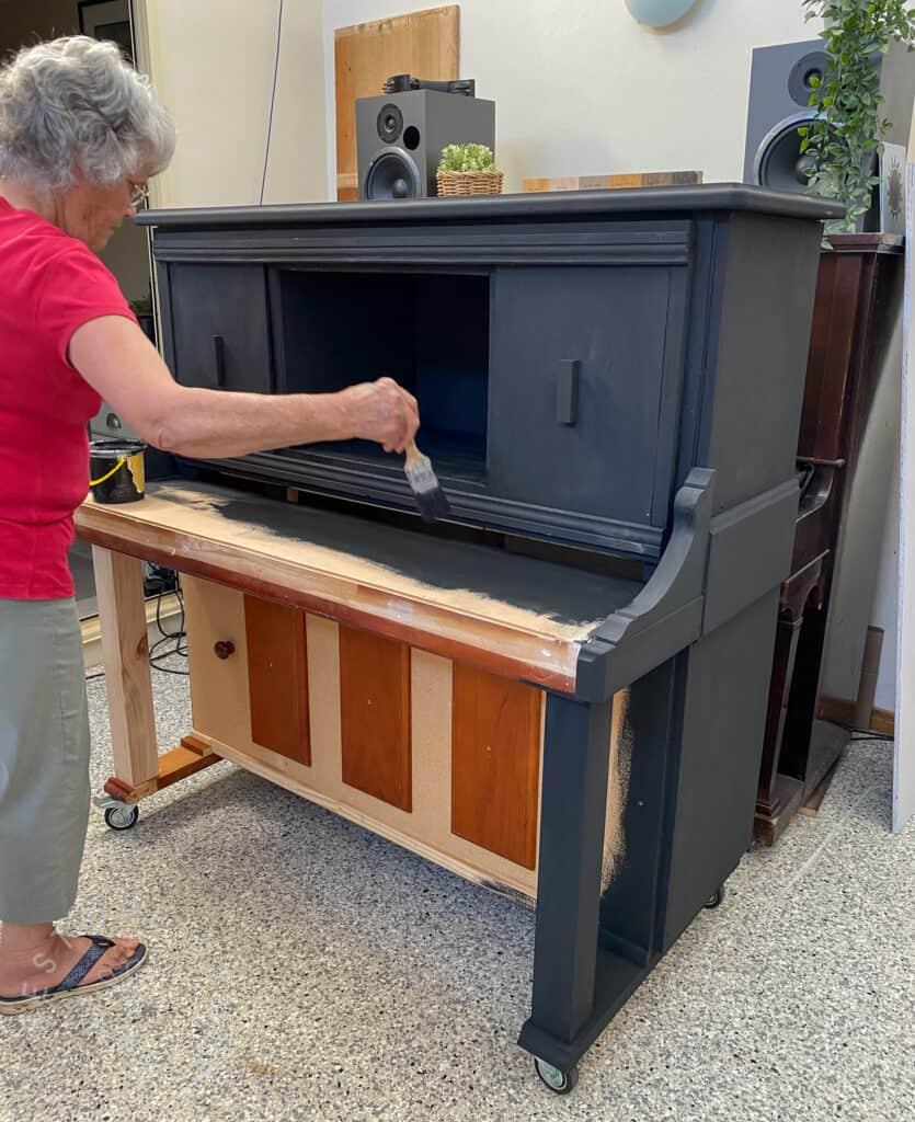 Mum painting piano